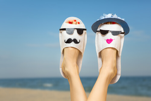 Holiday slippers on beach