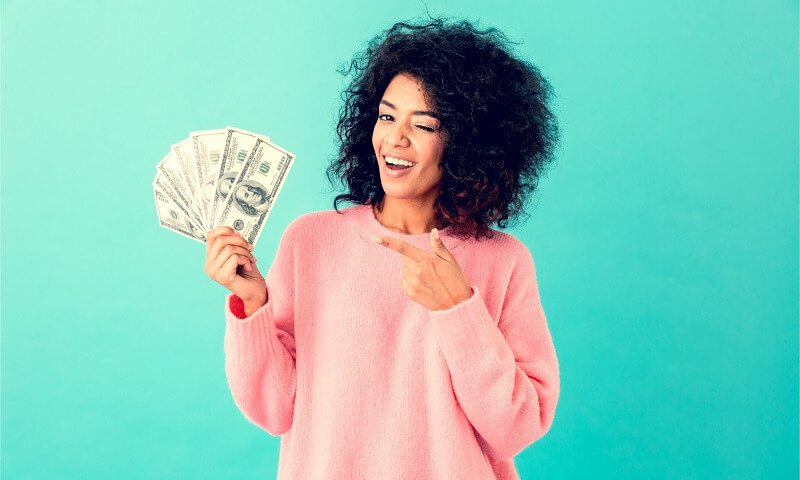 Woman with handful of money